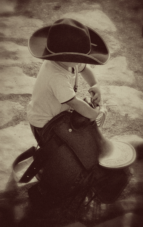 Little Man Packin' his Saddle