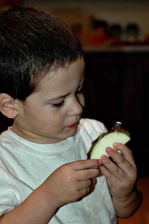 Little man eating apple