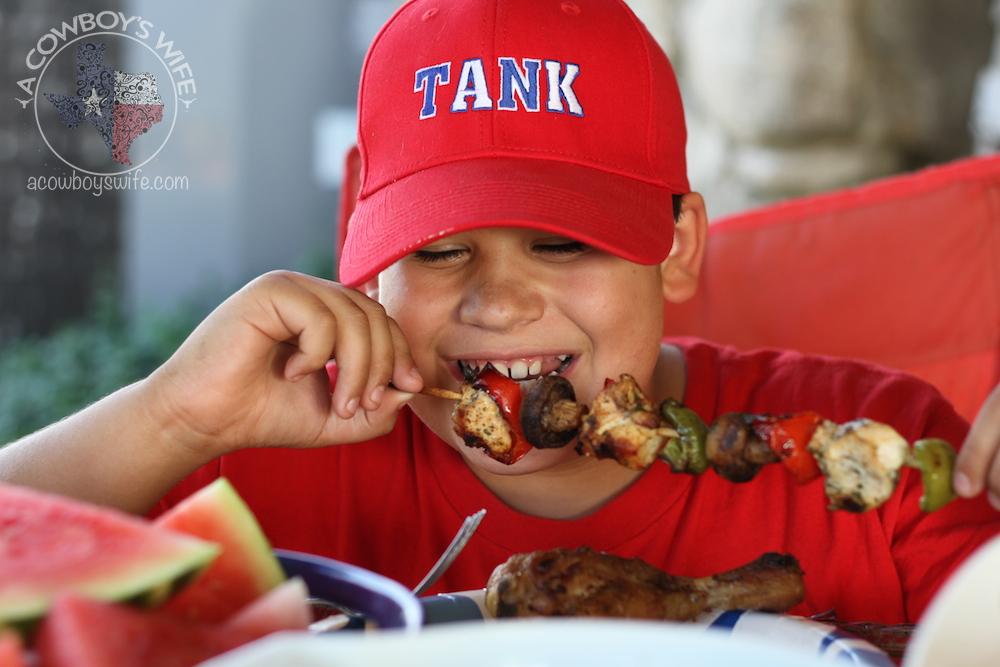 Truett eating chicken kabobs
